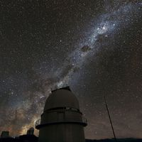 This 2011 handout photo provided by the European Southern Observatory, shows the Milky Way above the La Silla Observatory in Chile.  The more distant telescope in the photo was used to survey planets in our galaxy using a time consuming technique. The results indicate that on average there are 1.6 larger planets per star in our solar system, but thatÕs mostly looking at planets that are far from their star. Other methods look more on close-in planets and putting those techniques together, astronomers think that means stars in the Milky Way probably average well over two planets.  (AP Photo/Zdenek Bardon/ProjectSoft, European Souther Observatory) / SCANPIX Code: 436